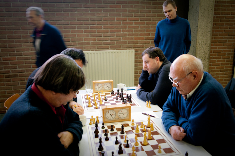 Colin Gilbert and Nicolas Rauta playing for Europchess 2. Kristian is kibitzing in the background